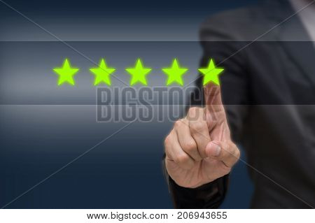 Businessman pointing five star symbol to increase rating of company or hotel on dark tone background business evaluation concept Increase rating, 3D illustration