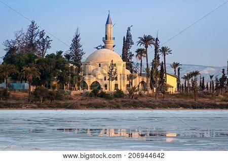 View of the Mosque of Umm Haram or Hala Sultan Tekke on the west bank of Larnaca Salt Lake near Larnaca Cyprus