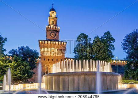 Sforza Castel (Castello Sforzesco) at night in Milan, Italy. This castle was built in the 15th century by Francesco Sforza Duke of Milan.