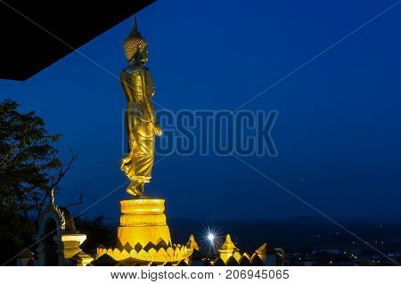 Buddha standing on a mountain at twilight time at Wat Phra That Khao Noi Nan Province Thailand public domain