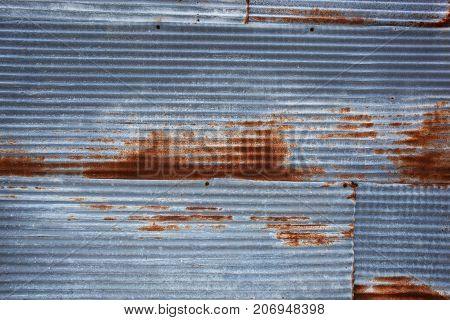 Old rusty zinc sheets for textured abstract background