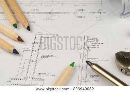 engineer construction business work concept : engineering blueprint diagrams paper drafting and industrial equipment technical tools selective focus