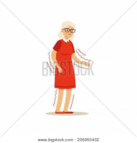 The image shows an old woman in red dress, who is shaking. She also has her glasses on.