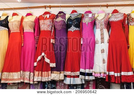 Bangkok, Thailand - January 30, 2016: Traditional Indian women's clothing for sale at the street market in Chinatown district, Bangkok, Thailand. Multicolored elegant dresses for beautiful women