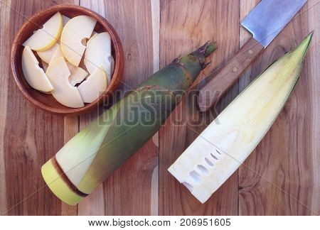 Bamboo shoots and Bamboo shoots slices in wooden bowl on wooden background