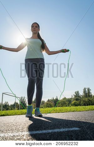 A Girl Is Jumping Rope On A Treadmill Of The Stadium