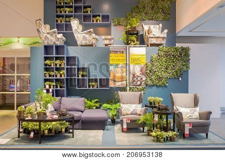NETHERLANDS - DELFT - SEPTEMBER 16 2017: Interior of the Ikea store in Delft in The Netherlands advertising discount on couches chairs and pillows.