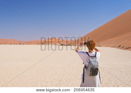 Tourist Taking Photo With Smart Phone At Sossusvlei, Namib Desert, Namib Naukluft National Park, Nam