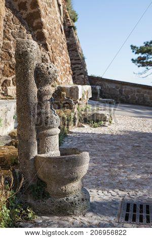 Old tuff fountain in Otricoli in Lazio, Italy.