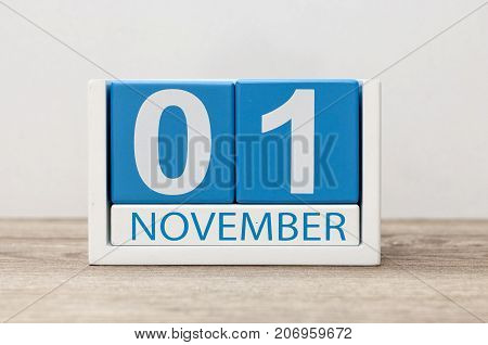 November 1st. Day 1 of month, wooden color calendar on light background. Autumn time.