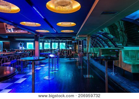 Luxury Chandeliers At Ceiling In Discotheque Interior