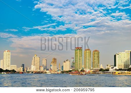 Bangkok, Thailand - January 9, 2016: Oriental Pier is the first pier of Chao Phraya Express Boat - popular boat travel and tourist attractions on both sides of the river. CAT Tower is in the background