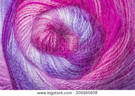 A super close up image of amethyst yarn Background of purple yarn knitting Lilac pinkwoolen thread