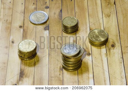 Euro coins on a wooden pallet background