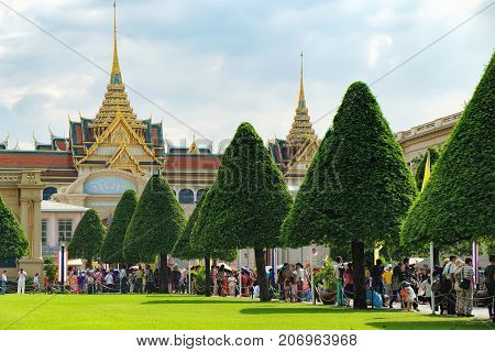 Bangkok, Thailand - December 8, 2015: Tourists visit the Grand Palace in Bangkok, Thailand. Grand Palace is the most famous temple and landmark of Thailand and the home of the Thai King