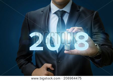 2018 Ideas Concepts With Businessman Hand Holding Light Bulb.
