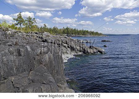 Steep Granite Shores Of Lake Ladoga. Karelia, Russia.