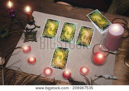 Tarot cards on fortune teller desk table. Reading future.