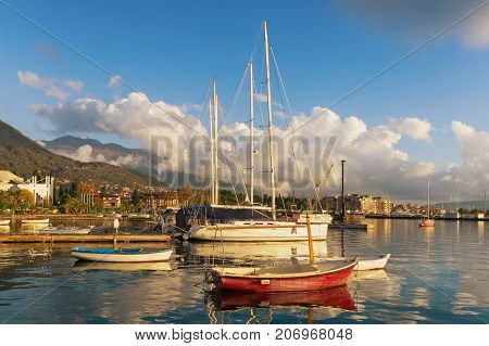 Yachts in the dock on a background of white clouds and blue sky. Tivat, Montenegro