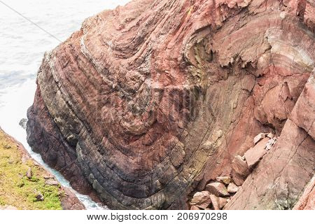 Syncline in above Mudstone and Sandstone Rock cliff Cobbler's Hole St Ann's Head Dale Pembrokeshire Wales United Kingdom.
