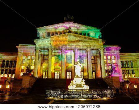 BERLIN GERMANY - SEPTEMBER 30 2017: Festival of Lights in Berlin - Illuminated Konzerthaus Berlin - concert hall on the Gendarmenmarkt square.