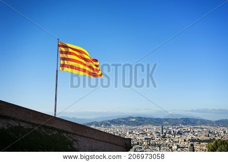 BARCELONA, SPAIN - 24.SEPTEMBER: Catalan Flag on Montjuic Castle over city of Barcelona Catalonia Spain in BARCELONA, SPAIN on SEPTEMBER 24, 2012.