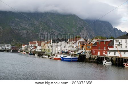 Houses at the water with boats and mountains on background Lofotens Norway