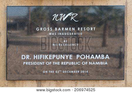 GROSS BARMEN NAMIBIA - JULY 4 2017: A plaque commemorating the official re-opening of the Gross Barmen Resort in 2014 near Okahandja in the Otjozondjupa Region of Namibia