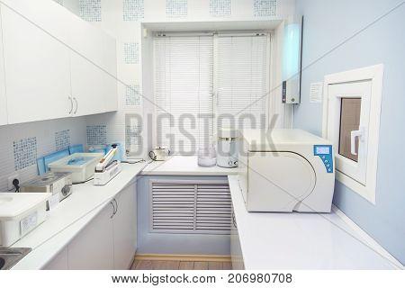Modern sterilization room interrior, handling of dental instruments workplace