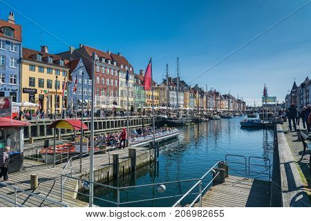 Copenhagen Denmark - september 3 2017: Nyhavn (New Harbour) is a 17th-century waterfront canal and entertainment district in Copenhagen. The canal harbours many historical wooden ships.