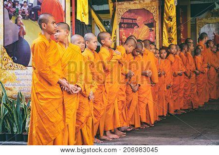 Bangkok, Thailand - January 31, 2016: Thai Buddhist young adult Monk Line up in Row and Waiting, Chinatown, Bangkok, Thailand.