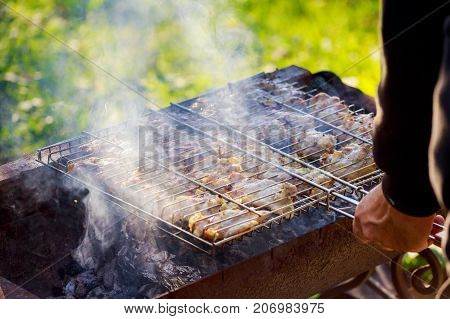 Grilled meat in barbecue with flames and coals. chicken meat grilled on the grill