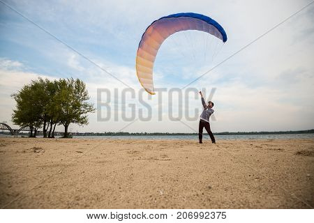Adventurer, With Focused Face, Learns To Controls A Kite