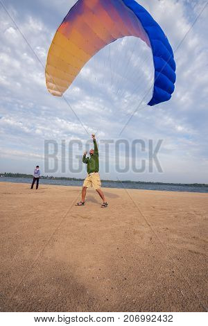 Friends Are Practicing To Control A Paraglider