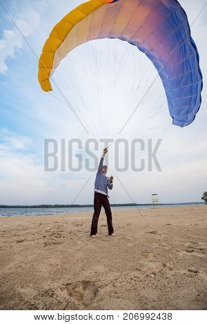 Concentrated Man Is Practicing To Control A Paraglider