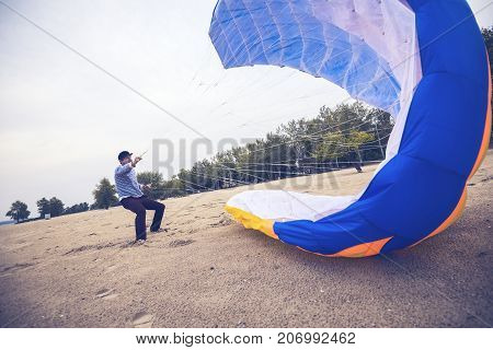 Strained Man  Catches A Wind With A Kite