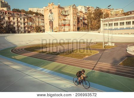 KYIV, UKRAINE - SEP 7, 2017: Active women in uniform cycling inside velodrome for sportsmen with cycles on September 7, 2017. Kiev is the 8th most populous city in Europe.