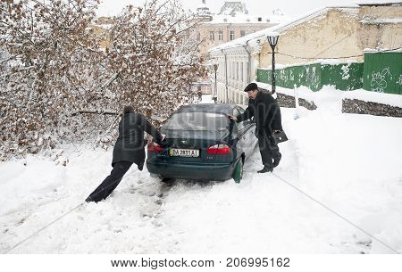 Kiev,Ukraine, December 29, 2009: Street Andrew's Spusk in Kiev, covered with snow