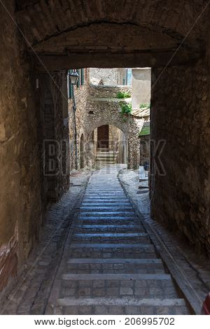 Alley with downhill staircase in an old village