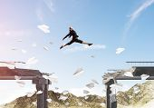 Business woman jumping over gap in bridge among flying paper planes as symbol of overcoming challenges. Skyscape with sunlight and nature view on background. 3D rendering. poster