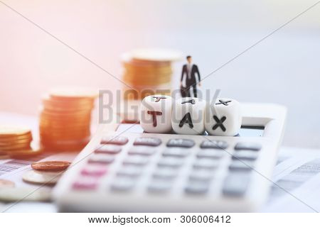 Tax Concept And Calculator Stacked Coins On Invoice Bill Paper For Time Tax Filling Paid Debt Paymen