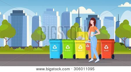 Womanputting Bucket With Paper Rubbish In Container Different Types Of Recycling Bins Segregate Wast