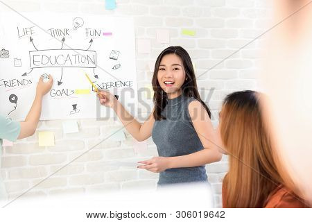Oversea Woman College Student Making A Presentation In Front Of Classroom