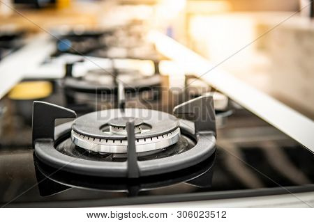 Modern Black Gas Stove On Countertop In Kitchen Showroom. Cooking Appliance In Domestic Kitchen. Hom