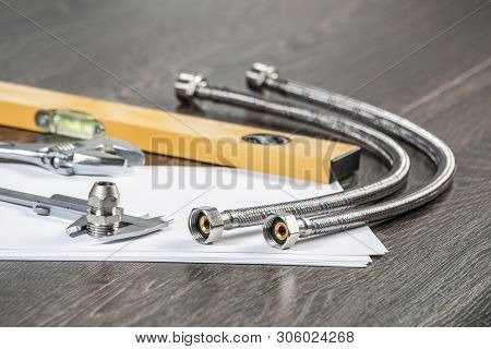Steel Water Fittings For Hydraulic System. Plumbing Pipeline Parts, Calipers And Level Tool Laying O