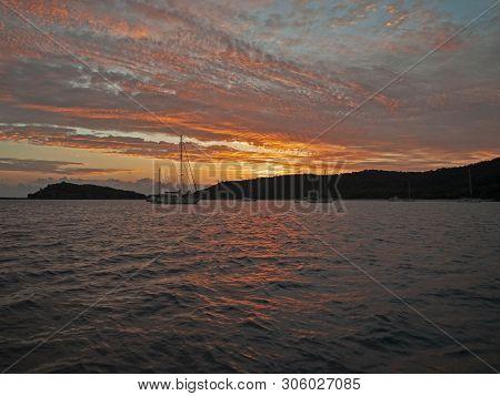 A Striking Vibrant Orange Coloured Nautical Stratocumulus Cloudy Coastal Sunrise Seascape Over Sea W
