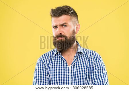 Beware Of The Facial Hair. Serious Hipster With Long Beard And Stylish Hair On Yellow Background. Br
