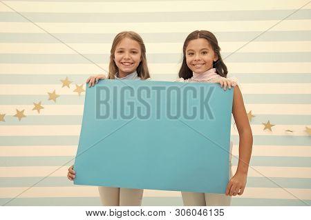 Kids Announcement Concept. Amazing Surprising News. Girl Hold Announcement Banner. Girls Kids Holdin