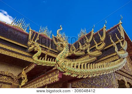 Naga Statue On The Temple Roof Of Thailand