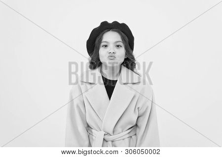 Duck face concept. Fashionable kid funny grimace face. Little fashionista posing. Kid funny face stand yellow background. Funny mimic expression. Kiss lips or funny duck face. Posing for camera. poster